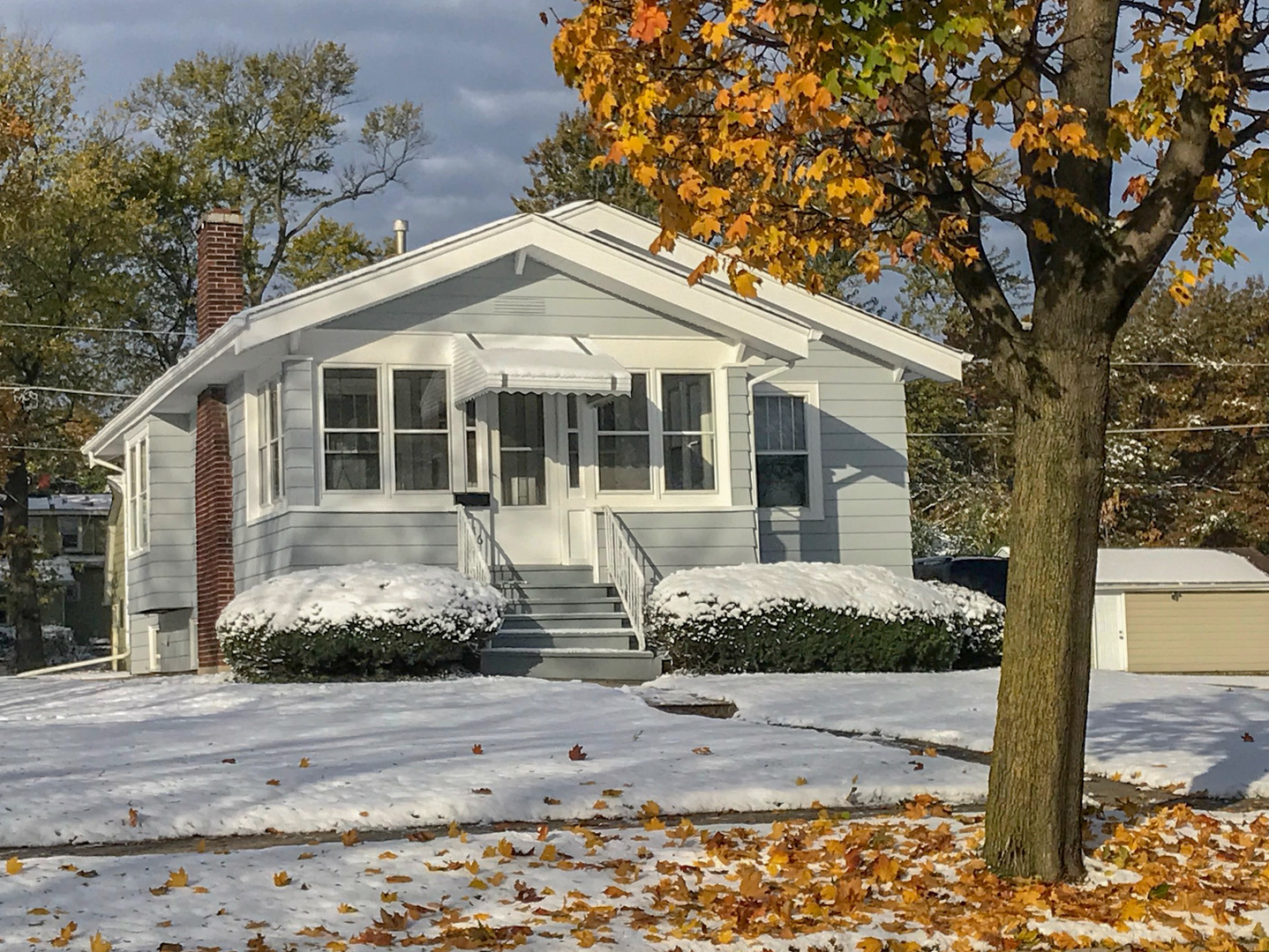 """Calling all rehabbers. This bungalow just a couple of blocks from the commuter train station would be a great investment. Full basement. Hardwood floors on main level. Electric fireplace (not wood burning).   Must be sold """"as is"""". Needs updating. 2.5 car garage. Sitting on an over sized 75X175 foot lot!"""