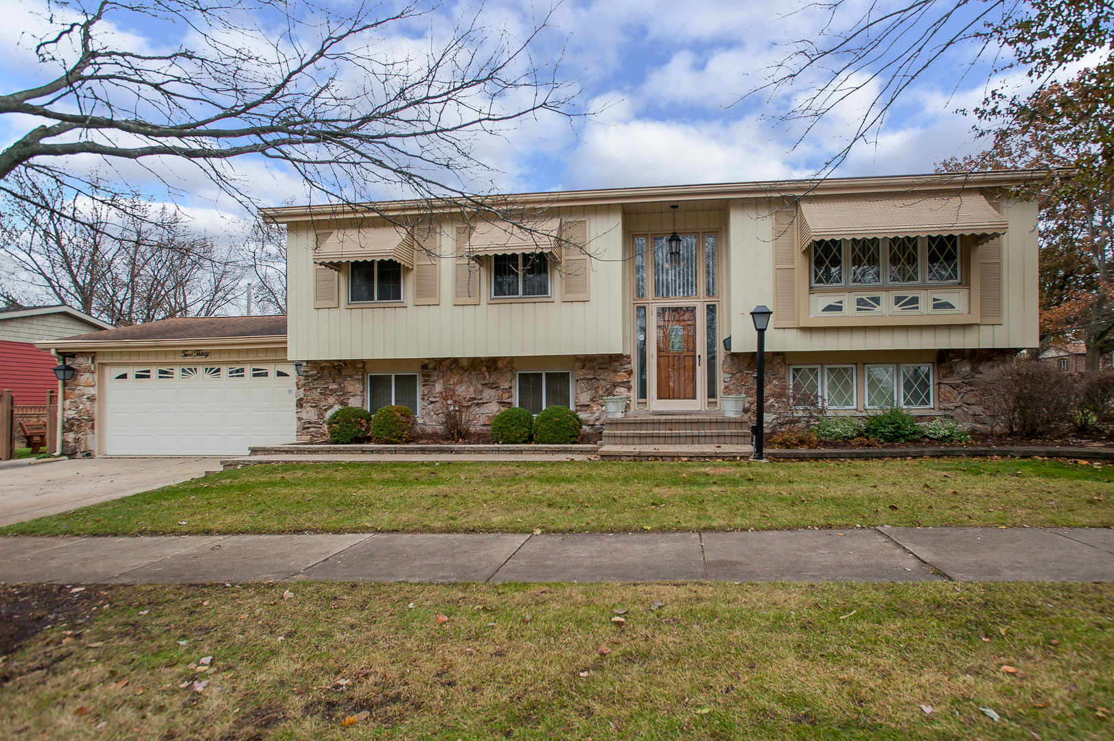 """Awesome 5 bedroom 2-1/2 bath home in sought after low tax District 48 has been cared for with extreme pride and is walking distance to highly rated grade school and high school. Main level featuring updated kitchen with tons of cabinetry and counter space, stainless appliances and beautiful back splash. Kitchen walks out to large 3 season room that overlooks professionally landscaped rear yard with two level paver patio. Spacious formal dining area and living room. 3 large bedrooms, spacious master with half bath. Lower level with two additional bedrooms, large family room and rec area. Gigantic laundry area with second kitchen. Attached 2 car garage. All baths recently updated. Please note, fireplace is """"as-is."""""""