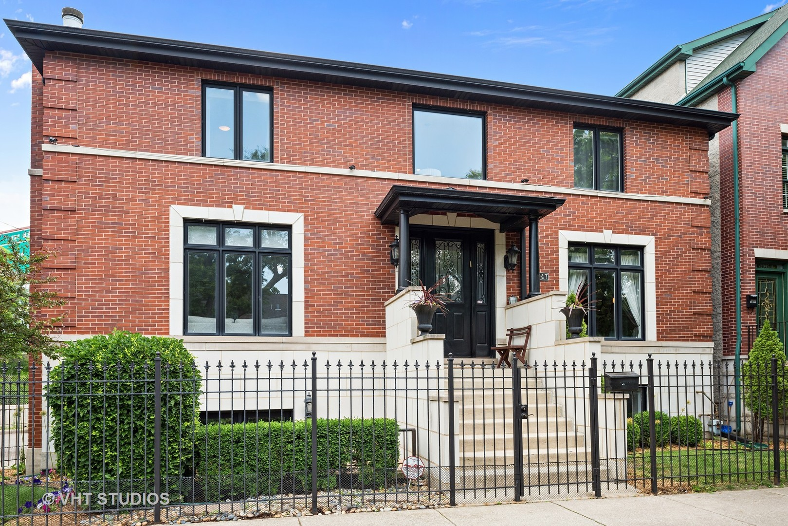 Contemporary brick SFH in amazing Bucktown location. First floor offers living room with fireplace,