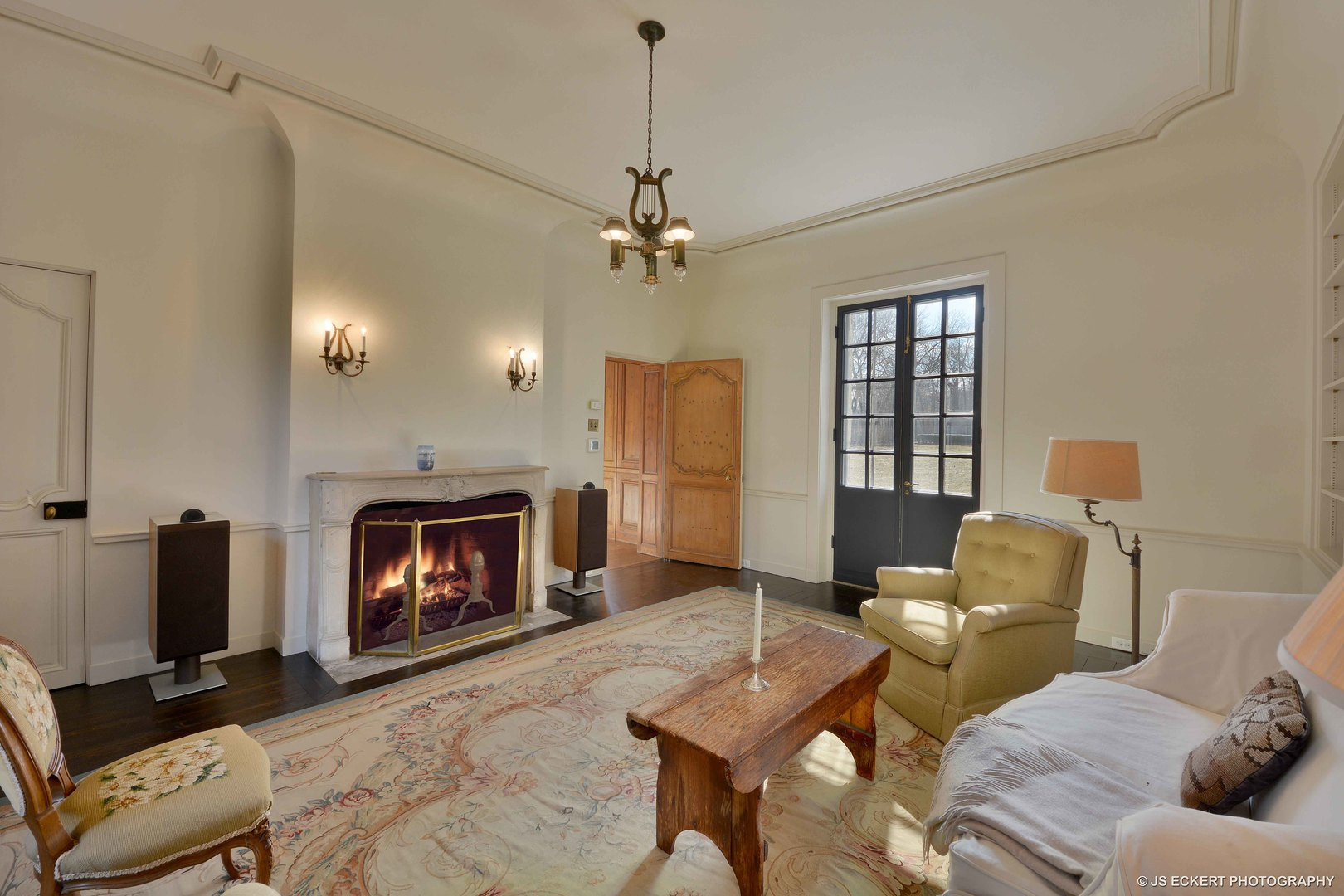 Beautiful limestone fireplace in a French chateau by David Adler known as the Carolyn More Ely House. Come see the tour of this amazing historic home for sale.