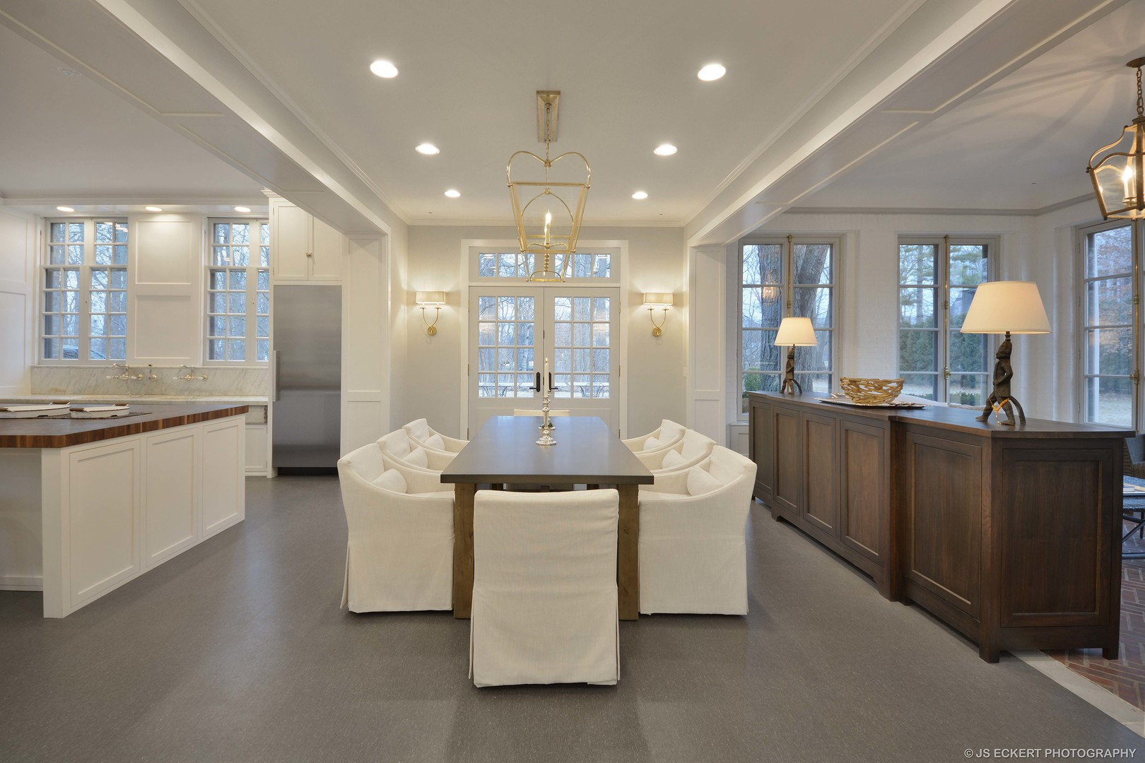 Modern and spare mostly white kitchen and breakfast room in a French chateau by David Adler known as the Carolyn More Ely House. Come see the tour of this amazing historic home for sale.