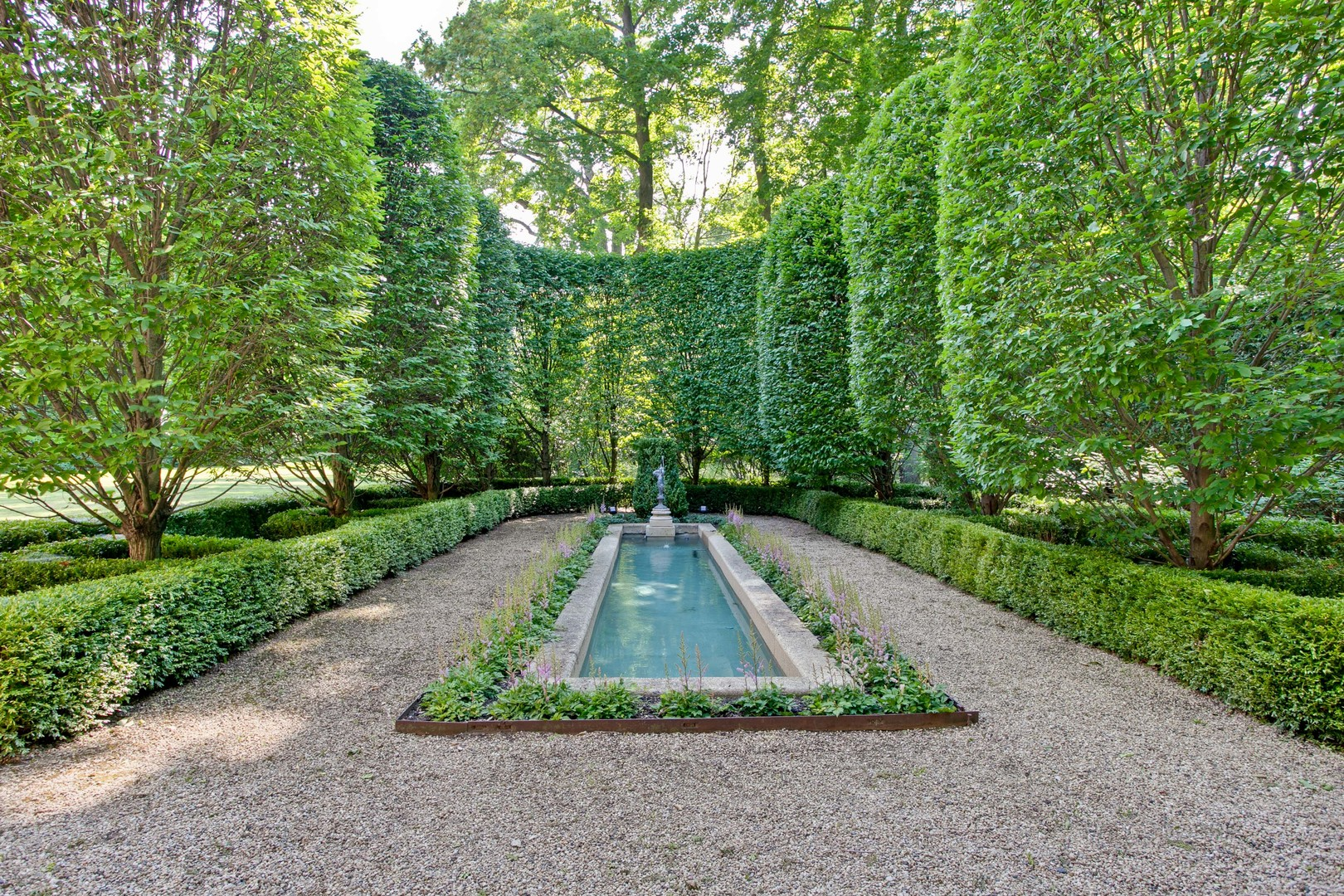 Breathtaking French gardens and outdoor dining at La Lanterne, a grand home designed by David Adler.
