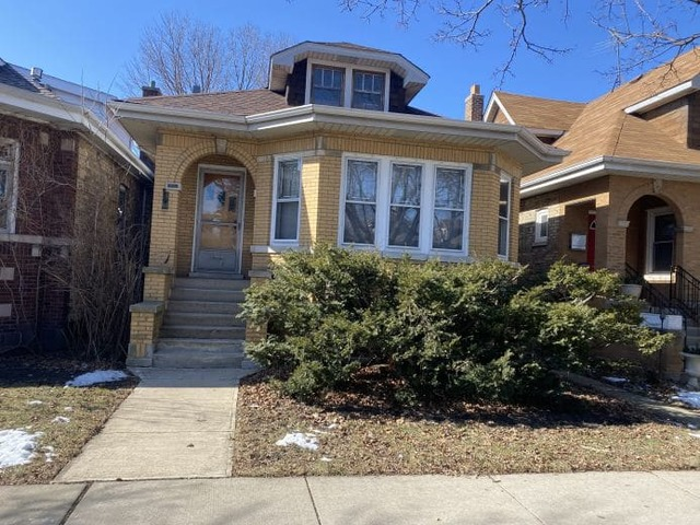 This classic Chicago brick bungalow with original stained glass windows and hardwood floors througho