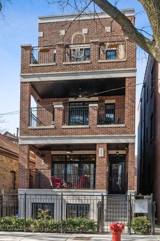 Stunning 4 bedroom/2.5 bathroom duplex down on a tree lined street in Lincoln Park in sought after O