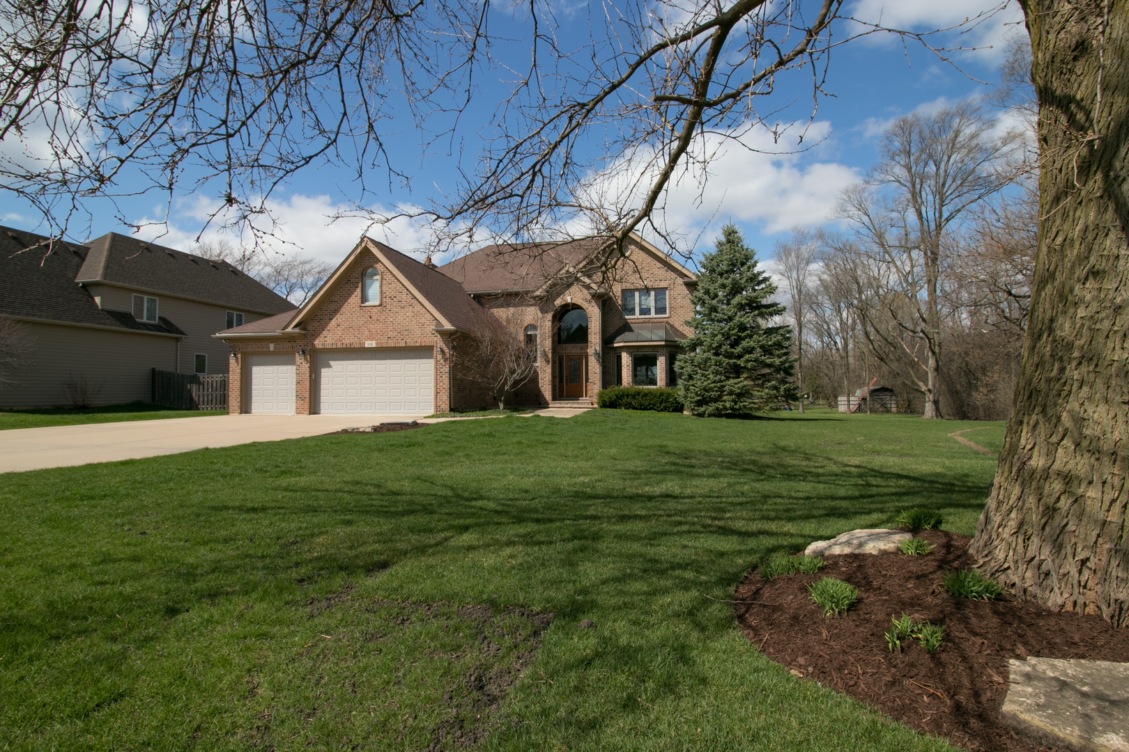 "Nestled on a quiet street on a double lot, this custom built home has everything! From the moment you walk in the two story foyer, you will love the generous room sizes and thoughtful design. Open kitchen with granite counters, double ovens, breakfast bar and sunny eating area spills into inviting family room with brick fireplace. Luxury master suite boasts whirlpool tub, separate shower, his and her walk-in closets. 2nd BR features full bath and walk-in closet, custom organizers in all closets! Spectacular basement includes rec room with fireplace, wet bar, workout area, full bath with walk-in shower, 5th bedroom, and huge storage area. First floor office has walk-in closet, and oversized first floor laundry has large closet, lots of cabinets, and a large fridge, too. Generator, plus too many ""news""! Park-like lot is over an acre and zoned for equestrian use, and includes a fire pit, attached three car garage, and large deck. Lot can be subdivided. Great location close to schools, sho"