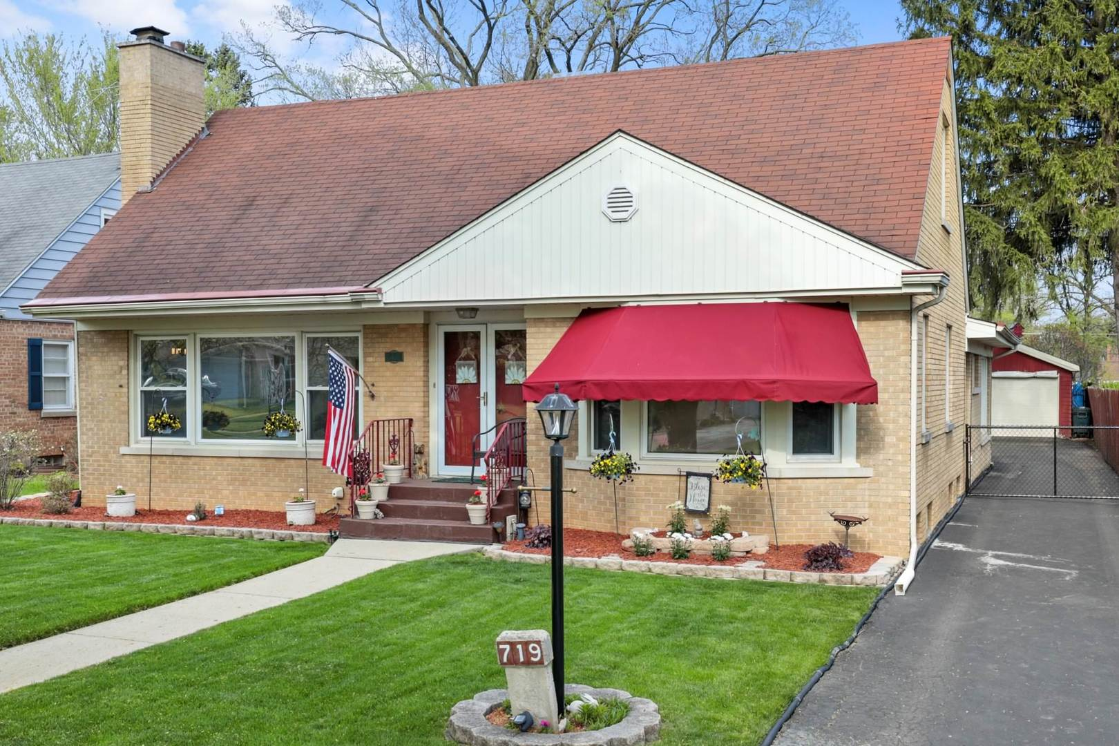 Money magazine has rated Villa Park as the 8th best town in the country to raise a family.  View this 5 bedroom 5 bath brick beauty located on a 300ft deep park-like lot and you will understand why. The main level features a gorgeous living room with gleaming hardwood and fireplace, expansive kitchen with island and combined eating area that opens to a massive family room with 2nd fireplace, 3 main level bedrooms, office, and 1st-floor laundry room. Rear main level bedroom and bath are perfect in-law set up. 2nd level has two large bedrooms with hardwood, full bath and tons of closet space. Ginormous finished basement with 2nd family room, shop area, stg/workout room , 2 more full baths and recreation room. Exterior entrance to the basement offers safety and convenience. Spectacular patio and built-in pool plus tons of rear yard space. See it to believe it!