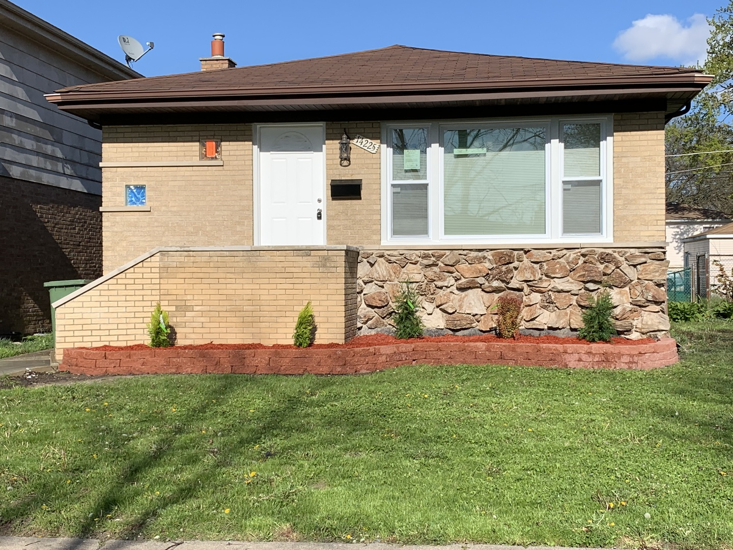 JUST COMPLETED! Beautifully Remodeled, Spacious all Brick Raised Ranch with tons of space for family