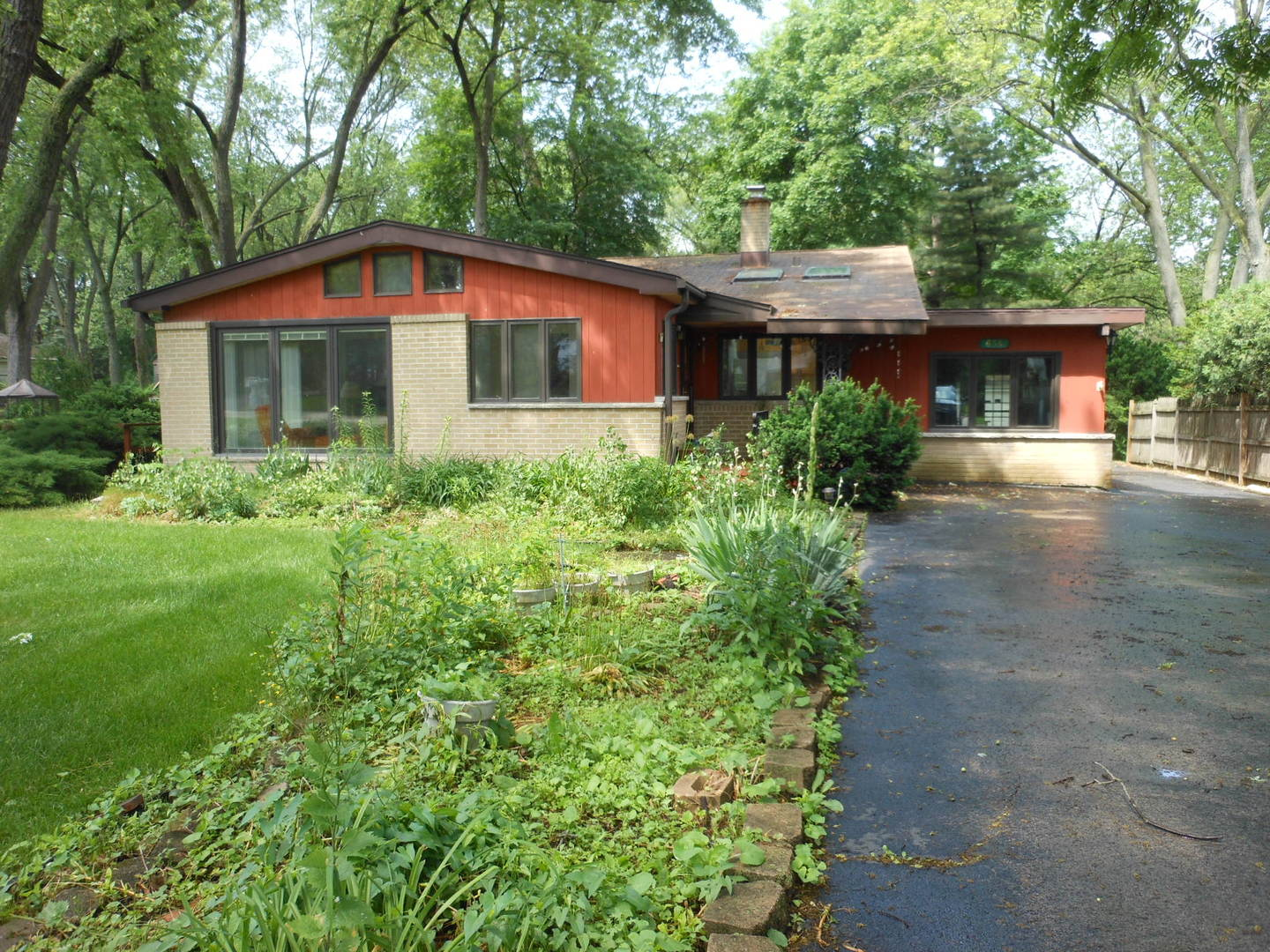 """EXTRA! EXTRA! - THIS SPACIOUS SPLIT LEVEL OFFERS EXTRA LIVING SPACE, EXTRA GARDEN/YARD SPACE & EXTRA GARAGE SPACE!  FRESHLY PAINTED INTERIOR, HARDWOOD FLOORS, SKYLIGHTS IN LIVING ROOM & KITCHEN, GREAT ROOM OFFERS NATURAL LIGHT & OPENS TO THE LIVING RM, KITCHEN W/CORIAN COUNTERS & APPLIANCES, SUN/FLORIDA ROOM OFF KITCHEN OFFERS MORE EXTRA SPACE, LOWER LEVEL FINISHED W/ FAMILY ROOM & 2ND BATH.  GUTTERS W/LEAF GUARD. LOCATED ON A QUIET STREET ON A HUGE, IN-TOWN LOT (67X310) THAT BACKS UP TO A WOODED AREA. BEAUTIFUL GARDENS THROUGHOUT YARD, A BRICK OUTDOOR GRILL, 3 SHEDS, HOUSE GENERATOR & HEATED 2+ CAR GARAGE W/EXTRA STORAGE.   SO MANY EXTRAS HERE!  PROPERTY IS AN ESTATE - BEING SOLD IN """"AS-IS"""" CONDITION"""